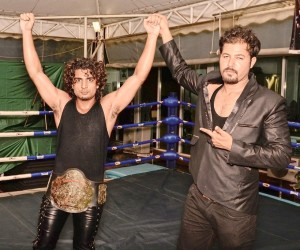 Baliyan Akki (left) as the Intercontinental championship winner . Vins from Wrestle Square (right)
