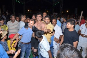 Malkeet Brawler celebrates his victory with wrestling fans.